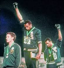 Tommie Smith (center) and John Carlos (right), Olympic 200 m medal ceremony, 1968.