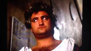 John Belushi at a toga party in the movie Animal House.