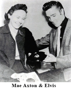 Mae Axton and Elvis looking at a single record of Heartbreak Hotel.